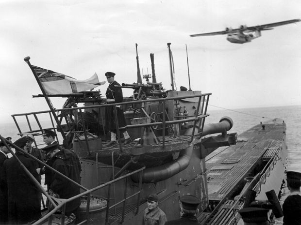 A surrendered German U-boat, flying the Canadian Navy flag in 1945. An East Coast group is trying prove that a protrusion near Muskrat Falls in Labrador is a long-lost Nazi submarine.