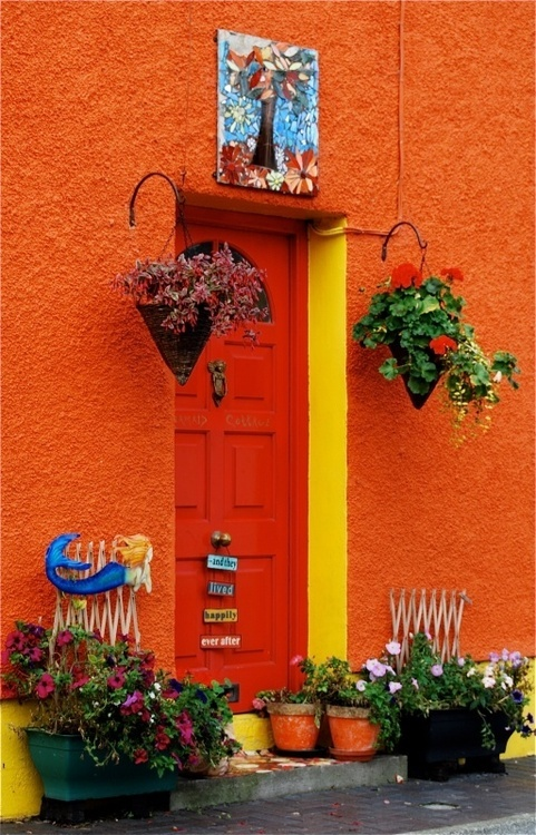 orange and yellow doorway with container garden