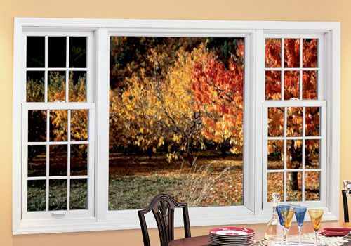 Renewal by Andersen replacement windows combination - picture window in center with one double hung window on either side.
