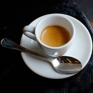 Espresso in Italy: The basic and most popular coffee served in Italy.  It is served in a little cup and has a creamy chocolate-like layer of foam.  An espresso is strong, dark and never bitter.  Espresso can be ordered long or short.