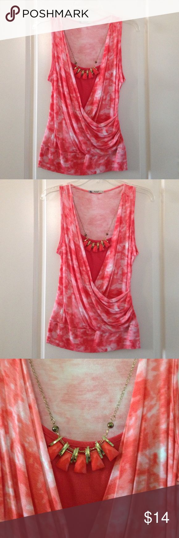 Pinky peach camouflage top w/necklace Pink/peachy colored camouflage short sleeve top. Comes with necklace. The front drapes beautifully. Worn once. Excellent condition. Papaya Tops Blouses
