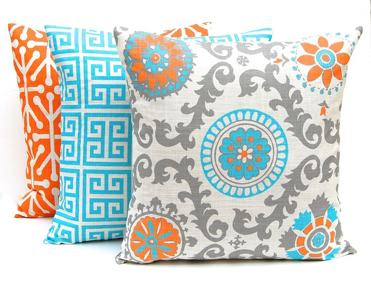 Turquoise, Orange and Gray on Natural20 x 20 Inches Suzani Greek Key Jacks.Love the color combo.