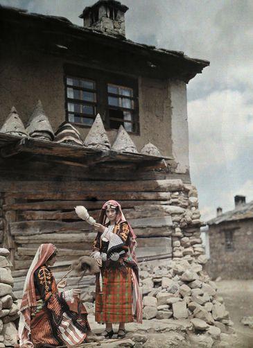 Islamic Bulgarian Pomak peasant women spinning wool yarn. Location: Bulgaria. 1932