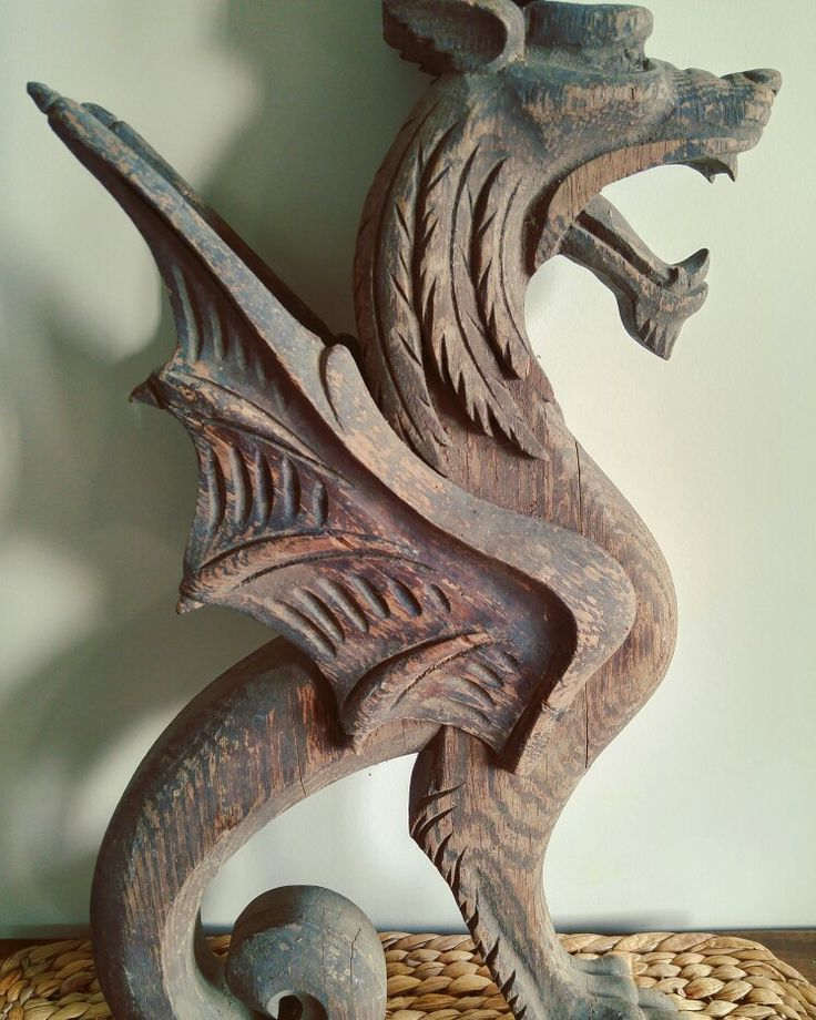 Picked this wood carved griffon at a barn sale. It looks like he was used as part of stairway railing. He's an amazing architectural piece! #griffon #griffin #gryphon #woodworking #woodcarving #dragon #mythology #mythical #mythicalcreature #mythicalbeasts #architecturalsalvage #vintage #salvage #carved #wings #corbels #railing #yardsalefind #barnsales #picking #rescue #reuse #repurpose #summermoonmercantile