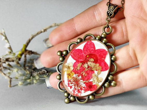 Red and yellow pressed flowers resin pendant by ByEmilyRay on Etsy