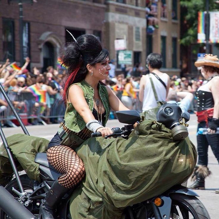 Chicago Pride Parade lady motorcycle riders, Bikes and Mics! All gender inclusive, LGBTQA community of motorcycle riders. This community of riders are cosplayers on wheels! #costume #cosplay #moto #pride #chicago #pride #parade #lstop #organized #lesbians #fun #dykes #queer #madmaxx #femmes #butches #allies #gays #nochaos #justFun #latina