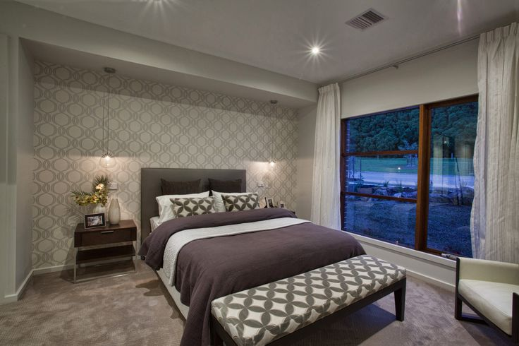 Absolutely love the circle wallpaper in this bedroom!