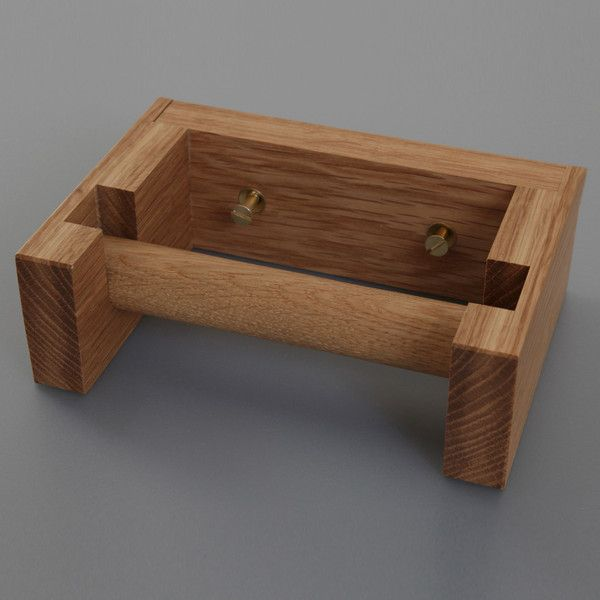 TOILET ROLL HOLDER  Price £22.00  We loved the simplicity of this wooden Toilet Roll Holder. Beautifully crafted in solid Oak in England, it comes complete with brass screws and fittings. Holds a standard toilet roll.     Dimensions: 17.5cm x 12.5cm x 5.5cm
