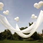 Floating Canopy - what an idea for a patio party where you need a little shade!