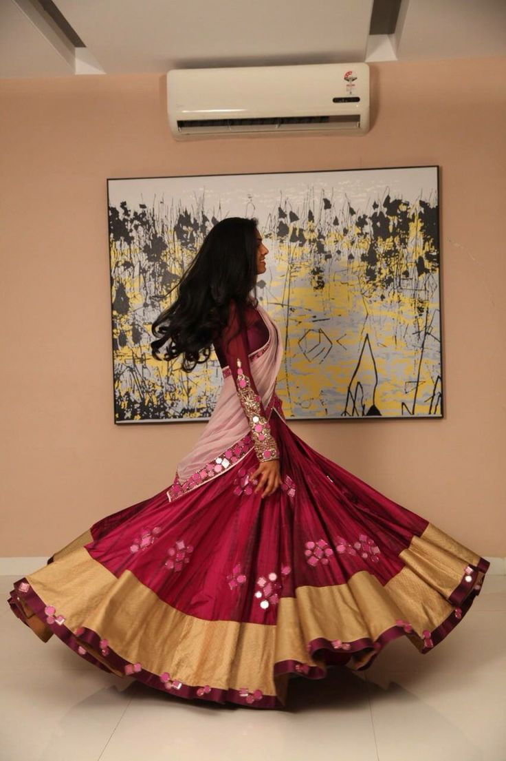 Pretty magenta and gold lehenga with blouse and dupatta. Indian fashion.