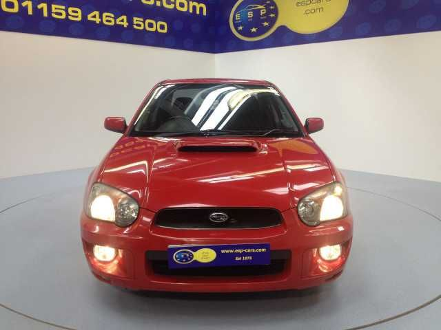 Subaru Impreza 2.0 WRX AWD Turbo 4-door saloon. Red. Main dealer service history. Click on pic shown for loads more.