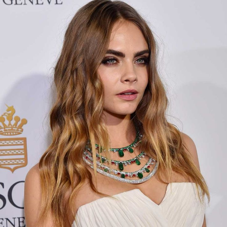 """Model Cara Delevingne turned heads at de GRISOGONO's """"Divine in Cannes"""" party wearing a unique four-row high jewellery necklace made of emeralds, diamonds and rubies."""