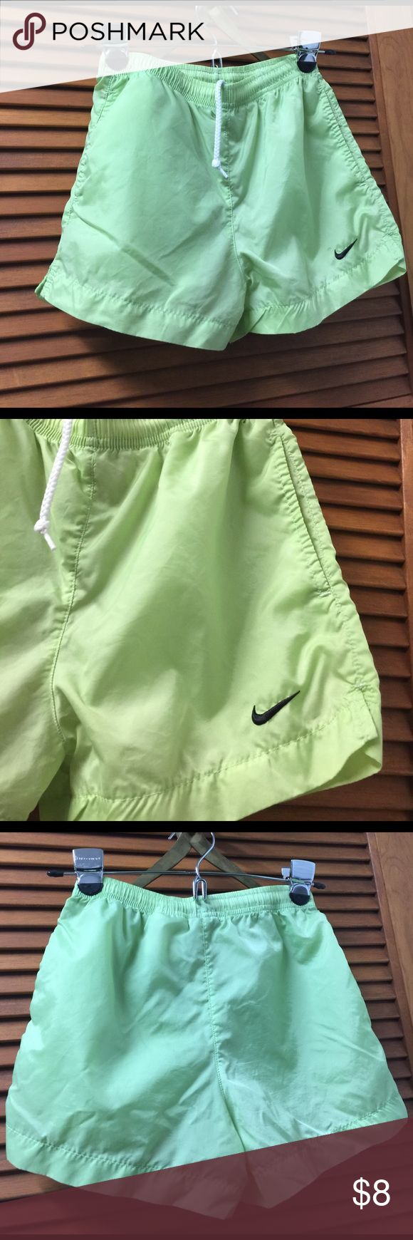 Nike Lime green Girls' Shorts Like new Nike Lime green Girls' Shorts are a lightweight nylon fabric. Timeless piece with draw strings. See pictures for fabric and care. Girls 7-8 Small Nike Bottoms Shorts