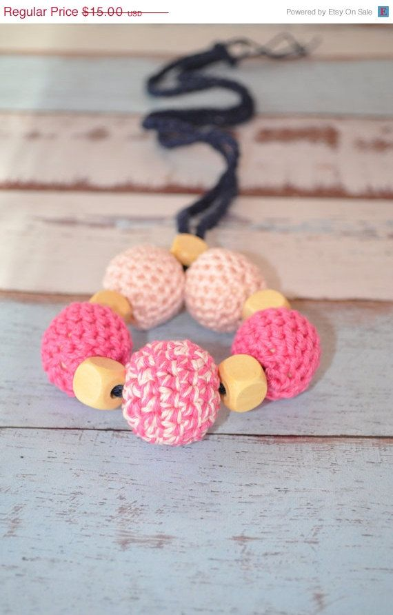Pink and navy are so classic and cute!  Great new mom or baby shower gift. #crochetbeadnecklace #teeethingnecklace #nursingnecklace #teething #ecofriendlybaby #ecofriendlybabytoy #teethingring