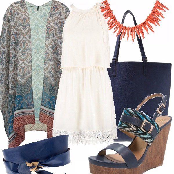 Abito corto con dettaglio in pizzo e scollo all'americana, kimono in fantasia astratta da chiudere con cintura alta blu, collana arancio, sandali con zeppa, maxi bag blu.