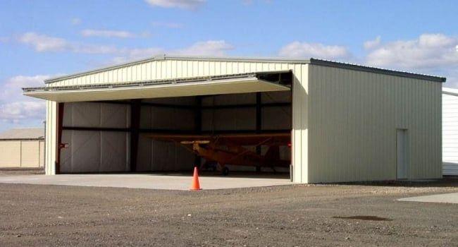 50 X 40 Steel Airplane Hangar With 36 X 13 Bifold Door Airplane Hangar Steel Buildings Steel Buildings For Sale