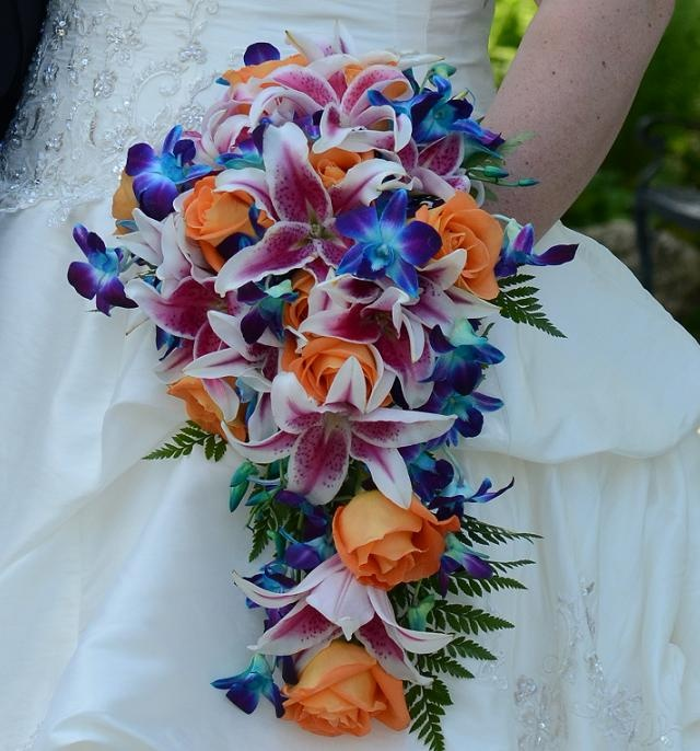 Our wedding flowers. Who knew blue orchids and stargazer lilies and ORANGE roses went together? :)