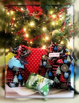 I made christmas fabric bags for all our gifts. Earth friendly,