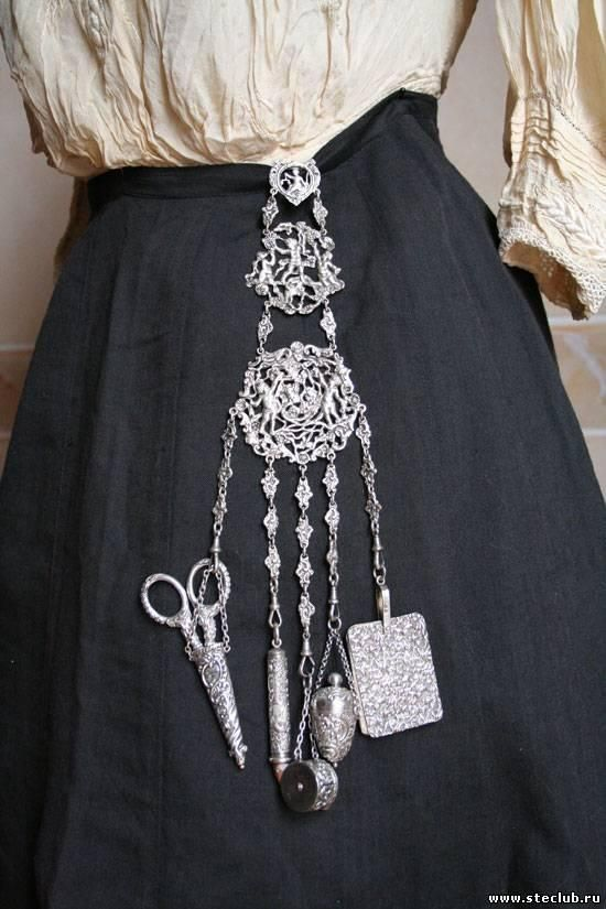 """""""Chatelaines were worn around the waist of well-to-do housewives in the middle class, and head housekeepers of the upper classes, in the 19th and early 20th centuries. From the belt chain would hang everything a woman might need in her day, from sewing kits to keys to coin purses. The quality of your or your servant's chatelaine was an excellent indication of status."""""""