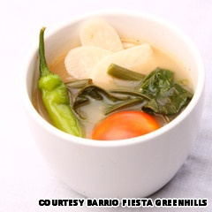 Sinigang is a stew of fish, prawns, pork or beef soured by fruits like tamarind, kamias or tomatoes.  Often accompanied by vegetables like kangkong, string beans and taro, this stew is eaten with rice