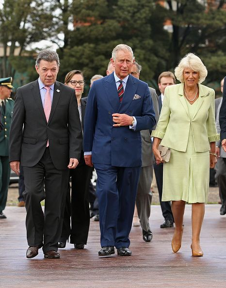 October 30, 2014 - Camilla and Prince Charles walk with President of Colombia, Juan Manuel Santos as they arrive at the Centre for Peace and Reconciliation in Bogota, Colombia