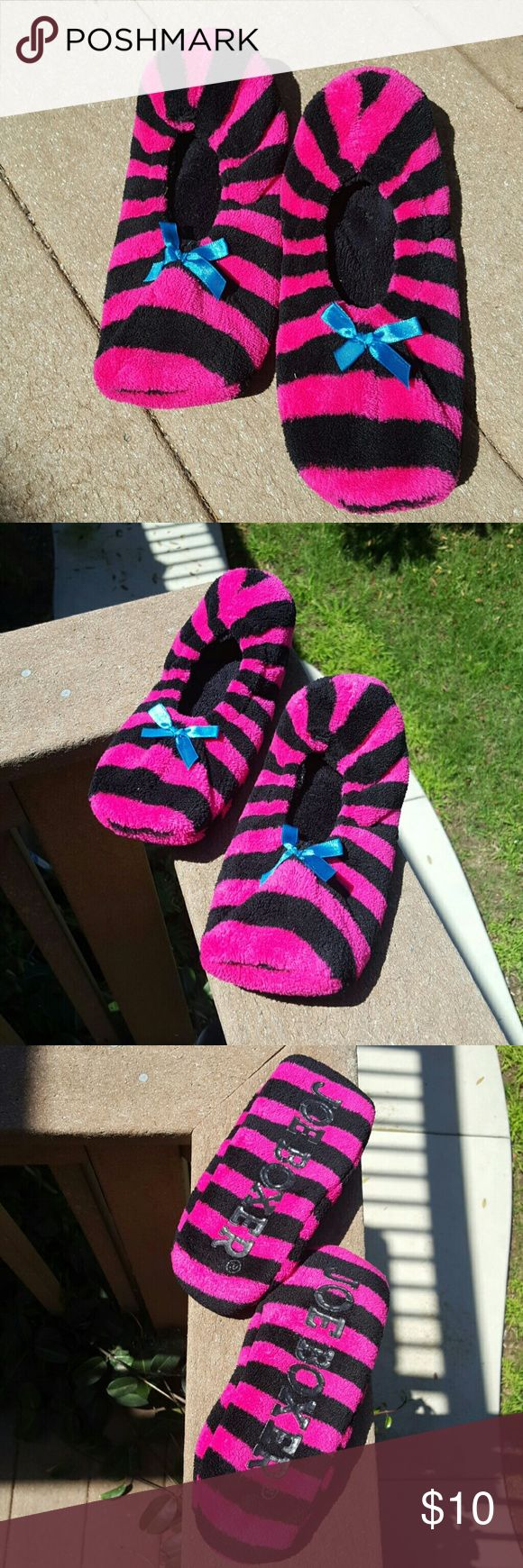 Joe Boxer Striped Slippers  NWOT NWOT  Joe Boxer pink and black striped slippers. Never worn. In excellent condition with no stains or rips. I thought I would have likes them but ended up never wearing them. No tag on slippers say size but I believe it would fit a 9 or 10. I primarily wear a size 10 and they fit perfectly.  Comes from a smoke-free home. Joe Boxer Shoes Slippers