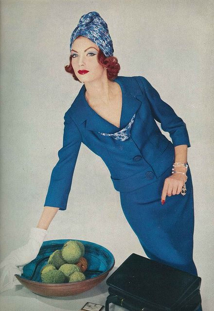 February Vogue 1958 by Henry Clarke    Suit is by Seymour Fox in Anglo wool, a ribbon in the same fabric as the turban closes the suits collar. Turban is by Adolfo of Emme.