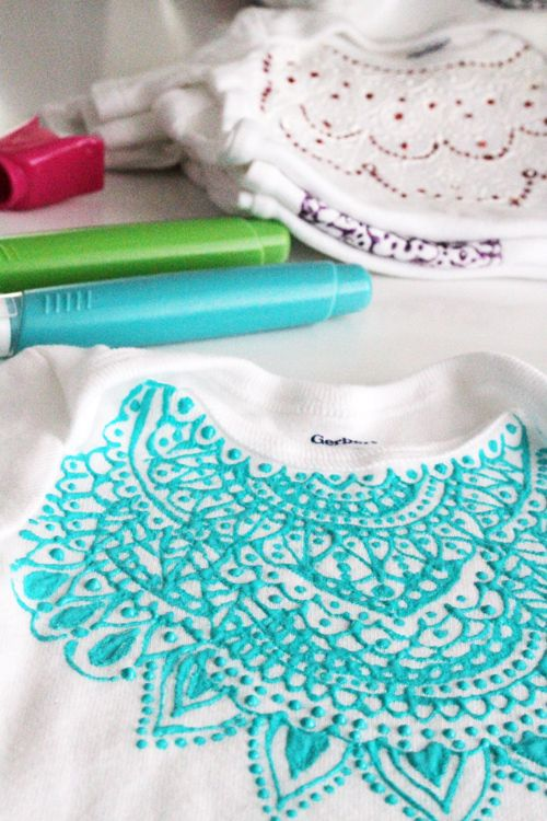 decorate plain onesies with puff paints - Alisa Burke. Very cool... love her designs - like partial mandalas.
