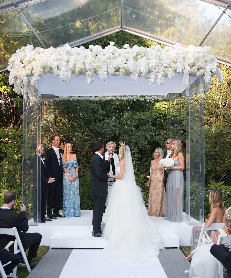 Modern Chuppah with Roses & Hydrangeas | Photography: Ira Lippke Studios. Read More:  http://www.insideweddings.com/weddings/contemporary-backyard-white-wedding-under-clear-tent-in-chicago/857/