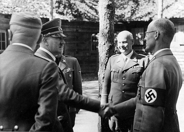 Führerhauptquartier 'Werwolf' (Vinnitsa Ukraine) Adolf Hitler with Minister Dr. Otto Thierack (center) and the Secretary of State at the Ministry of Justice Dr. Curt Rothenberger (right) back to the camera, Dr. Hans Heinrich Lammers - 1942