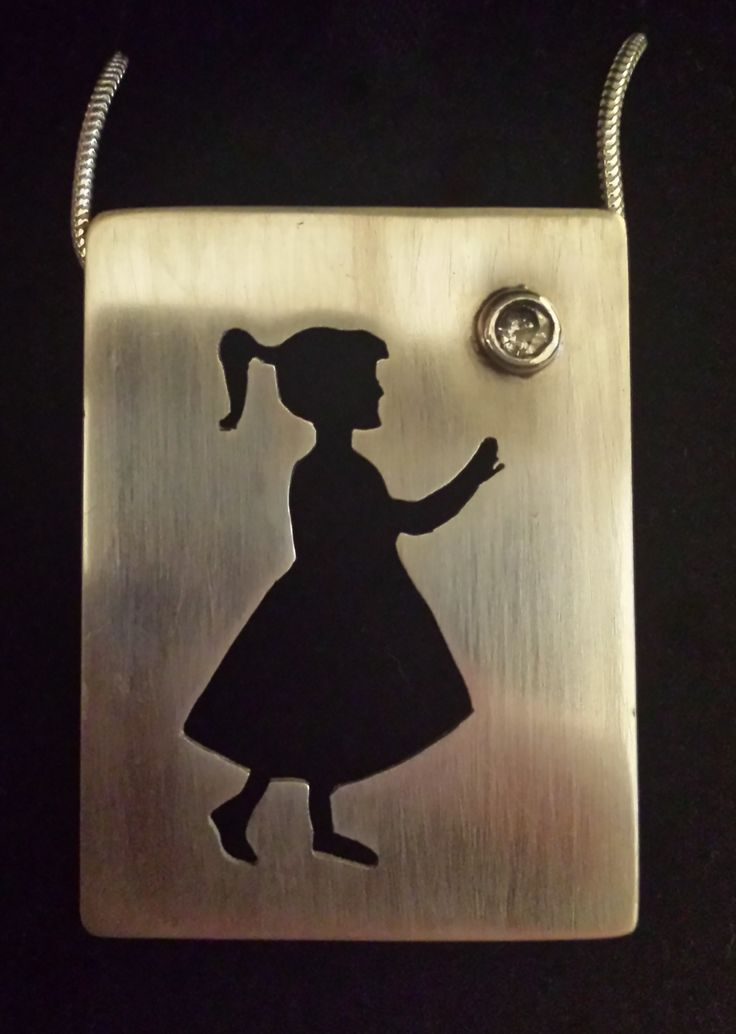 Little girl silhouette with cubic zirconia