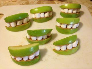 Shrek Lips = Granny Smith Apples, Peanut Butter & Marshmallows! My kids love these!