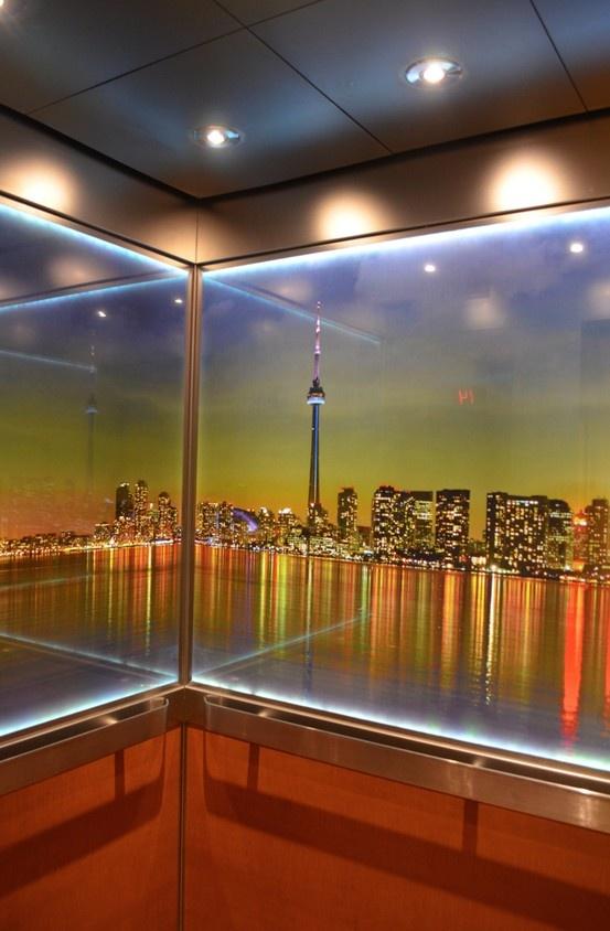 Illuminated Toronto Skyline Makes This Elevator Interior Glow Both Day And Night