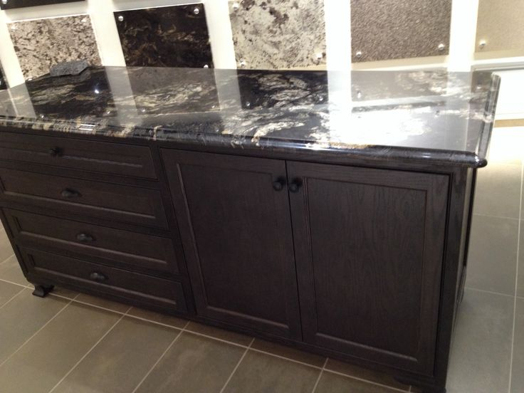 12 best images about granite titanium on pinterest for Brown kitchen cabinets with black granite