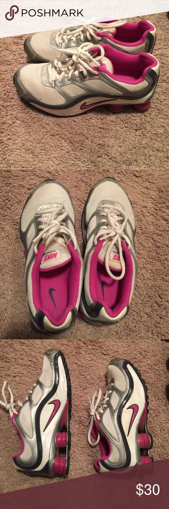 Nike shocks White with grey and pink trim. Not worn much, size youth 5.5. Almost new. Nike Shoes Athletic Shoes