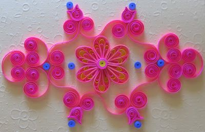 Quilling  or paper filigree  is an art  form that involves the use of strips of paper  that are rolled , shaped, and glued together to creat...