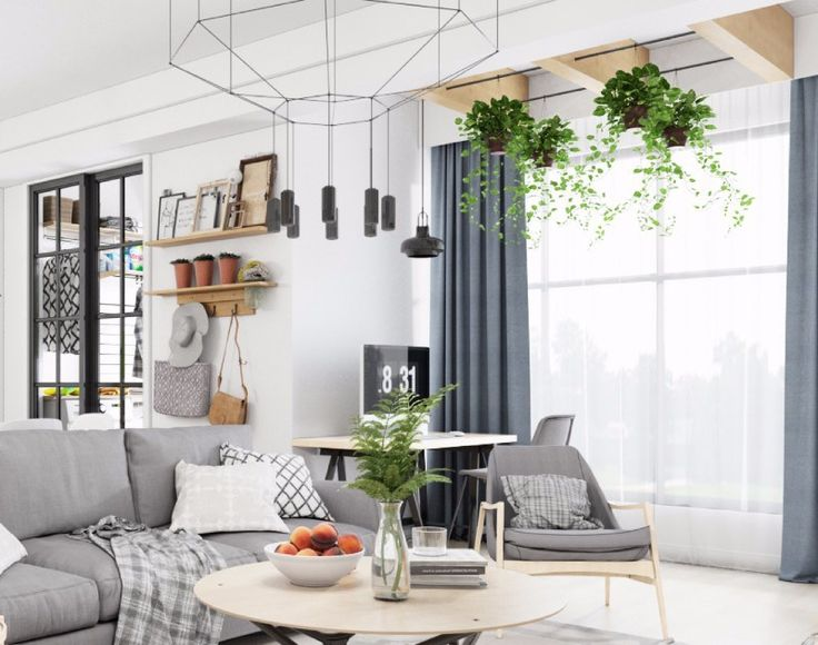 A blend of nature and contemporary #homedesigns would always be a staple in the #décor world. This Scandinavian #interiordesignidea is dotted in a variety of textures and tones with a Scandinavian frame to add a little bit of #style to it. The #rug and the chandelier above share matching patterns thus making this ensemble an ultra-glamorous #design.