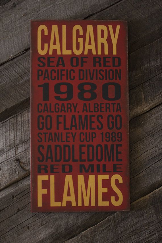 This Calgary Flames sign is painted on a red, distressed background. It comes with a sawtooth hanger attached to the back, and is ready to hang. This sign does NOT have a sealant on it, and is not recommended for outdoors.  DETAILS: • black and yellow on red background • made of Baltic Birch • 5/8 thickness • 10 (w) x 20 (h)  I do accept orders for custom variations on size and color. *Price will vary on custom orders.  PLEASE NOTE: No two signs will be EXACTLY alike. Each one is painted...