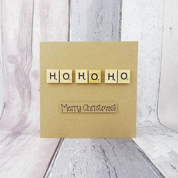 This handmade Christmas card features Scrabble alphabet tiles spelling out: HO HO HO followed by the message: Merry Christmas! The sentiment on this Scrabble Christmas card is added with 3D foam and in combination with the Scrabble tiles reads: HO HO HO Merry Christmas! Please note that