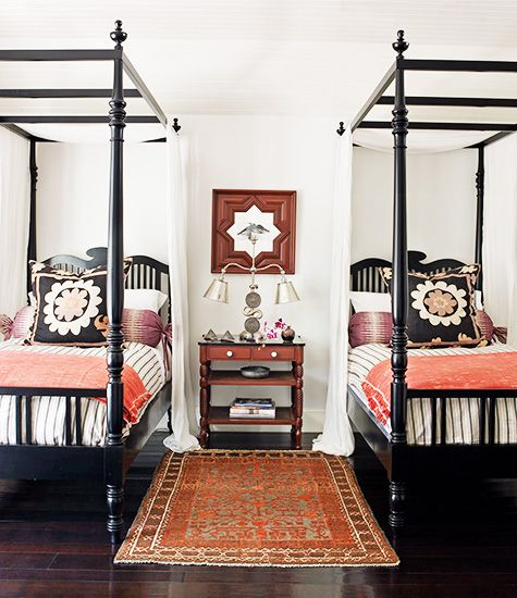 the perfect pair.  These canopy beds feel fresh with a coat of black paint + mix of patterned and printed bedding.