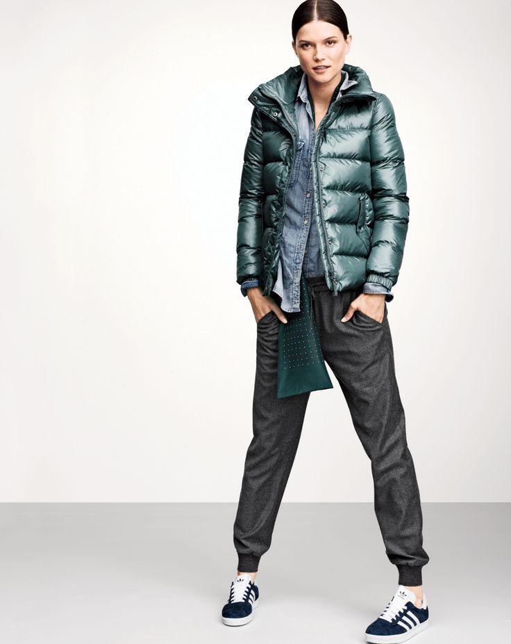 OCT Style Guide: J.Crew women\u0027s shiny puffer jacket, chambray shirt, drapey  sweatpant, silk tie scarf, and Adidas gazelle sneakers.