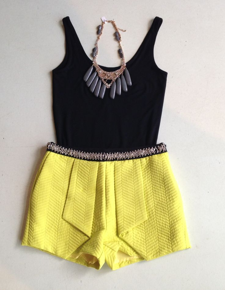 Smart Spring outfits. Pair a dark tank with bold color shorts. Don't forget to add the statement necklace!