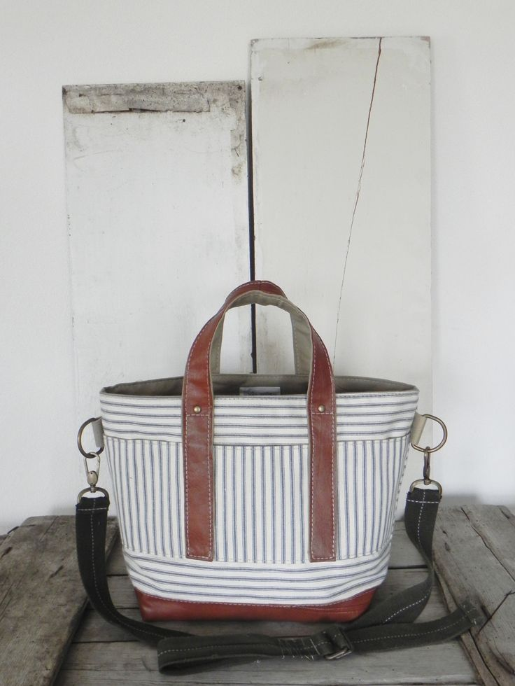 Tote bag made from 1950's era ticking fabric, a reclaimed leather jacket, and an upcycled belt, A Well Worn Story
