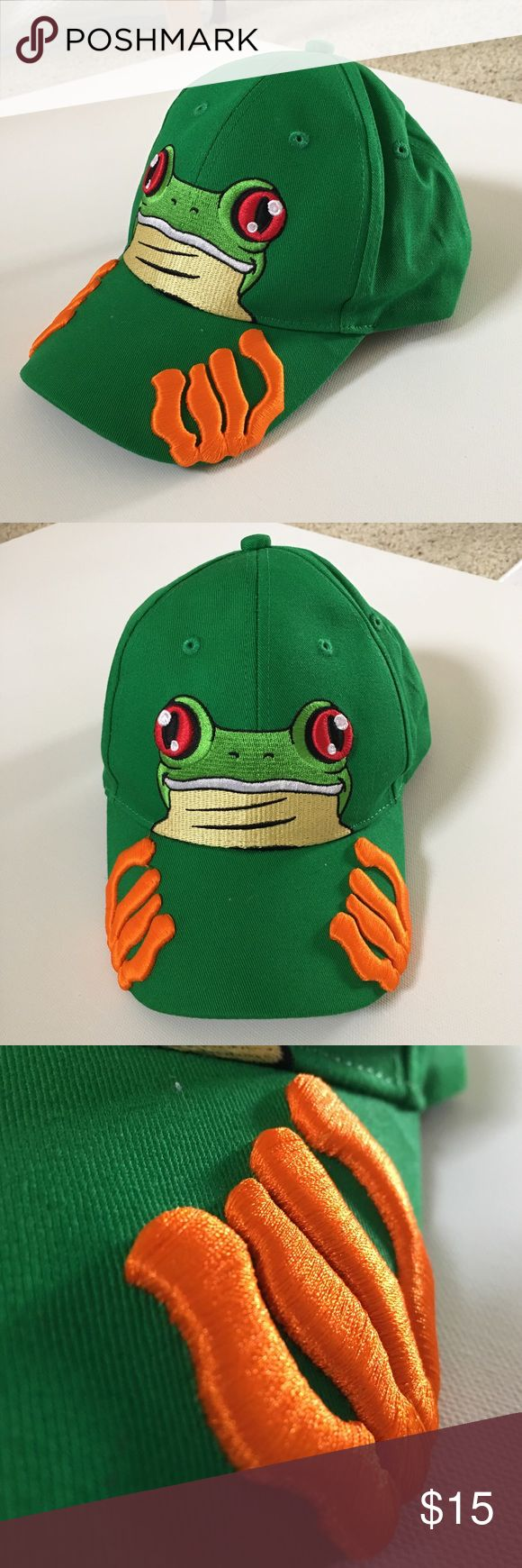 """Tree Frog Baseball Cap Beautiful bright green baseball cap from Costa Rica with an embroidered red eyed tree frog and 3D orange webbed feet that wraps around the bill.   21"""" if the Velcro is fully covered. Can go up to 23"""" max. It's probably for a teenager or adult with a smaller head, but I was able to wear it (but still fits a bit small) after letting more Velcro out.  Never worn! Accessories Hats"""
