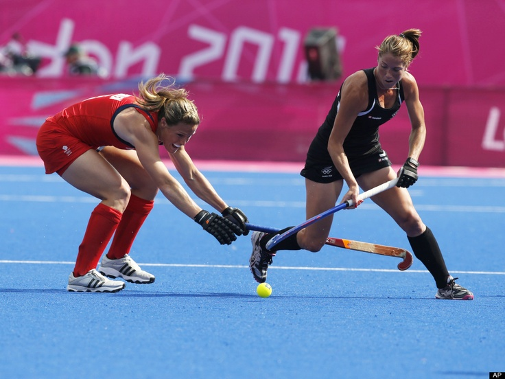 Britain's Georgie Twigg, left, and New Zealand's Krystal Forgesson vie for the ball during the women's field hockey bronze medal match at the 2012 Summer Olympics, Friday, Aug. 10, 2012, in London.