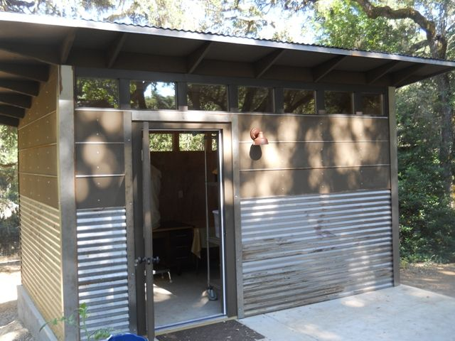 modern shed. corrugated metal siding on lower 1/3rd of house. horizontal.