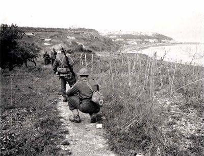This is a picture of Canadian soldiers going along a path into Ortona and how they are being very sneaky and not get caught before they want to be. This shows Canadian soldiers being courageous and it also shows slightly how it is hand to hand combat where the soldiers stand alone with not much back up besides other soldiers. This is a credible source because it gives lots of information about how the Canadian soldier went into Ortona and is a picture taken from the time period.