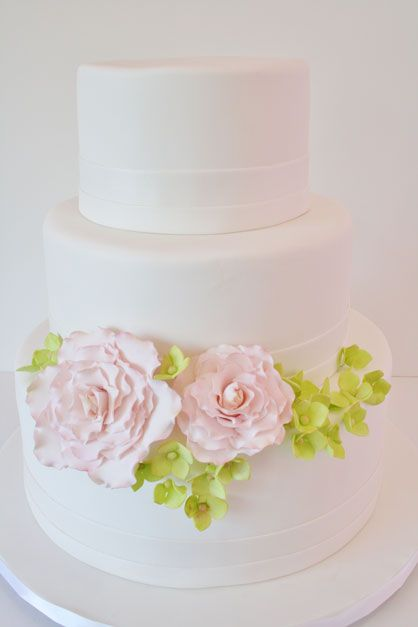 Love the flower design on the cake. would like more styling on the cake itself just to bring it out a little.