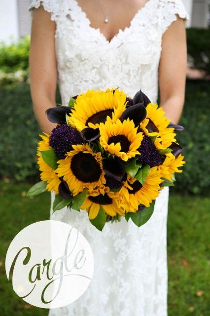 Summer bridal bouquet of yellow sunflowers and plum calla ...