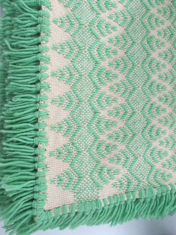 This is a beautiful green and white Vintage Swedish weaving, Huck weaving monks cloth blanket, throw. Hand made by Anna Newsome. The many stitches were beautifully done on pre-shrunk natural Monks Cloth with 100% acrylic yarn which will not run or fade. It is 48 by 88 in size with fringe on two ends. (Big enough for two). There is one small flaw as seen in pic #5 which can easily be tied off.  History: Swedish Weaving or the name Huck Embroidery is a large scale form of embroidery done on…